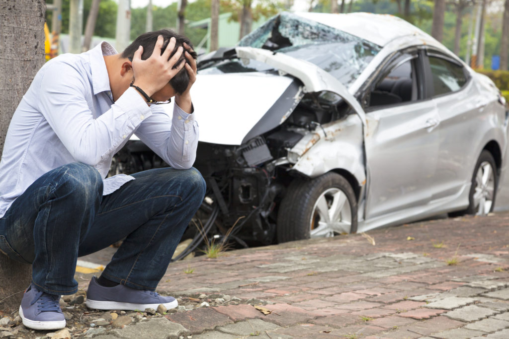Man feeling stressed after witnessing an accident